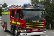 Two people rescued from flat after tea light sets fire to bed