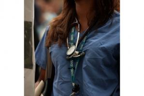 Junior doctors stage 'masked march' over pay and conditions