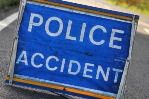 Crash between a car and a motorbike in Charminster